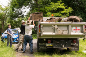 Loading a heavy box on the dump truck.